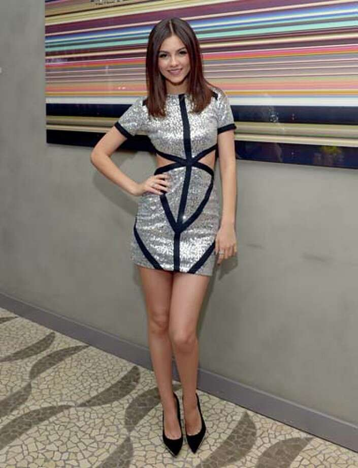 Victoria Justice combines geometric stripes and cut outs. Photo: Charley Gallay, Getty Images For Vitaminwater / 2013 Getty Images