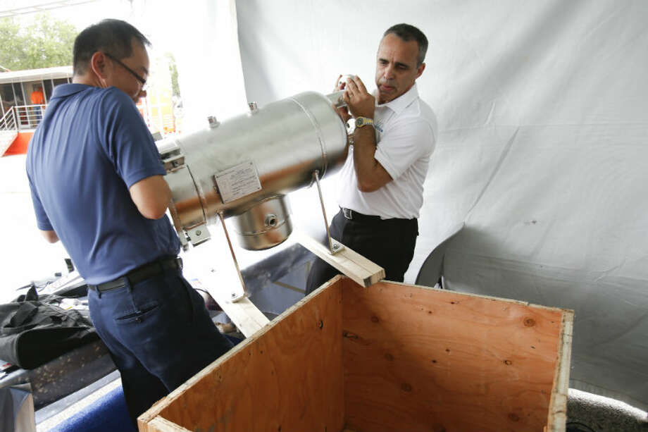 MDA Filtration packs up on the final day at the Offshore Technology Conference May 9, 2013 in Houston. (Eric Kayne/For the Chronicle)