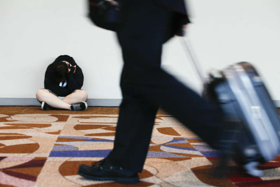 An attendee naps as the Offshore Technology Conference winds down May 9, 2013 in Houston. (Eric Kayne/For the Chronicle)