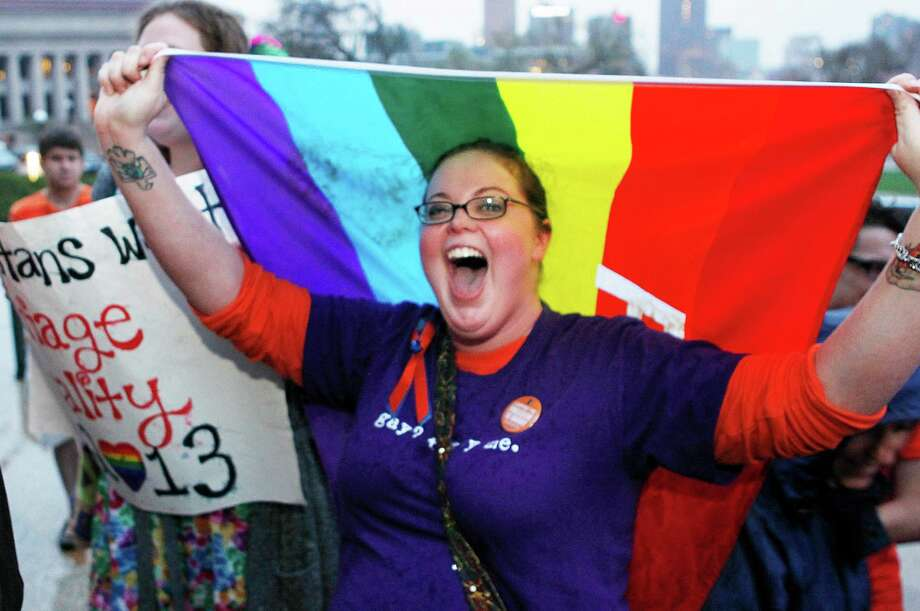 Rachel Ford cheers during a rally supporting a same-sex marriage bill in Minnesota on the steps of the State Capitol  in St. Paul, Minn., on Wednesday May 8, 2013. The Minnesota House is scheduled to debate and vote Thursday on a measure that would make the state the 12th in the country to allow gay marriage. (AP Photo/Andy Clayton King) Photo: Andy Clayton King