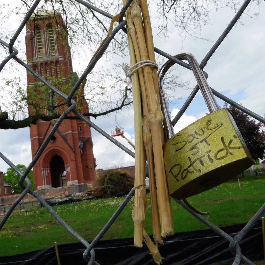The demolition of the former St. Patrick's Church on Thursday May 9, 2013 in Watervliet N.Y. (Michael P. Farrell/Times Union) Photo: Michael P. Farrell / 00022323A