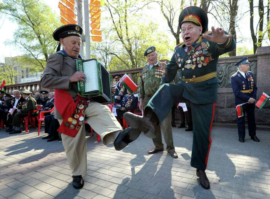 Belarus Warld War II veterans dance during Victory Day celebration in Minsk, on May 9, 2013. Belarus as well as the other former Soviet republics celebrates the 1945 victory over Nazi Germany on May 9, the date of the Nazis' capitulation to the Soviet Union, which took place in the evening on May 8, 1945 (May 9 by Moscow Time), following the original capitulation Germany agreed earlier to the joint Allied forces on the Western Front. Photo: VIKTOR DRACHEV, AFP/Getty Images / AFP