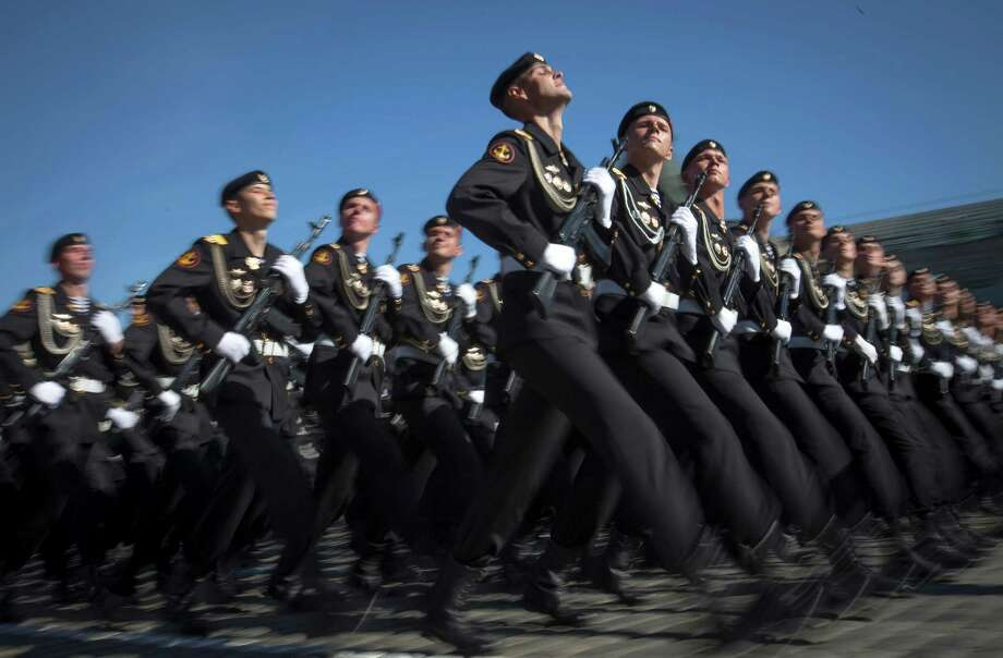 Russian marines march through the Red Square, during the Victory Day Parade, which commemorates the 1945 defeat of Nazi Germany in Moscow,  Russia, Thursday, May 9, 2013. Russian President Vladimir Putin has said at the annual military parade on Red Square that Russia will be a guarantor of world security. Putin's short speech Thursday came at the culmination of Victory Day, marking the defeat of Nazi Germany 68 years ago. It is Russia's most important secular holiday, honouring the huge military and civilian losses of World War II and showing off the country's modern arsenal. Photo: Alexander Zemlianichenko, Associated Press / AP