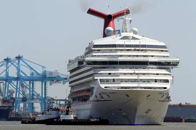 The Carnival Triumph departs from the Alabama Cruise Terminal in Mobile, Ala., Wednesday, May 8, 2013. The ship had docked for repairs in Mobile for about three months after it limped into port  because of an engine-room fire that disabled the vessel. Photo: Mike Kittrell, Associated Press / AL.com