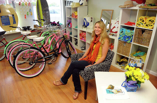 Tina Pritchard poses inside her new business Scoot & Paddle on Naugatuck Avenue in Milford, Conn. on Thursday May 8, 2013. She rents out kayaks, bike and scooters for the beaches and surrounding community. Photo: Christian Abraham / Connecticut Post