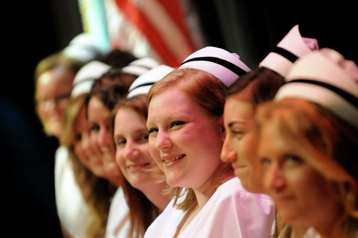 Graduate Carissa Luther, center, and fellow graduates are all smiles during the Samaritan Hospital School of Nursing college commencement on Thursday, May 9, 2013, at Hudson Valley Community College in Troy, N.Y. (Cindy Schultz / Times Union)