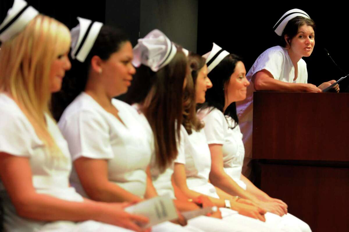 Graduate Valerie Kneeland, right, addresses fellow graduates during the Samaritan Hospital School of Nursing college commencement on Thursday, May 9, 2013, at Hudson Valley Community College in Troy, N.Y. (Cindy Schultz / Times Union)
