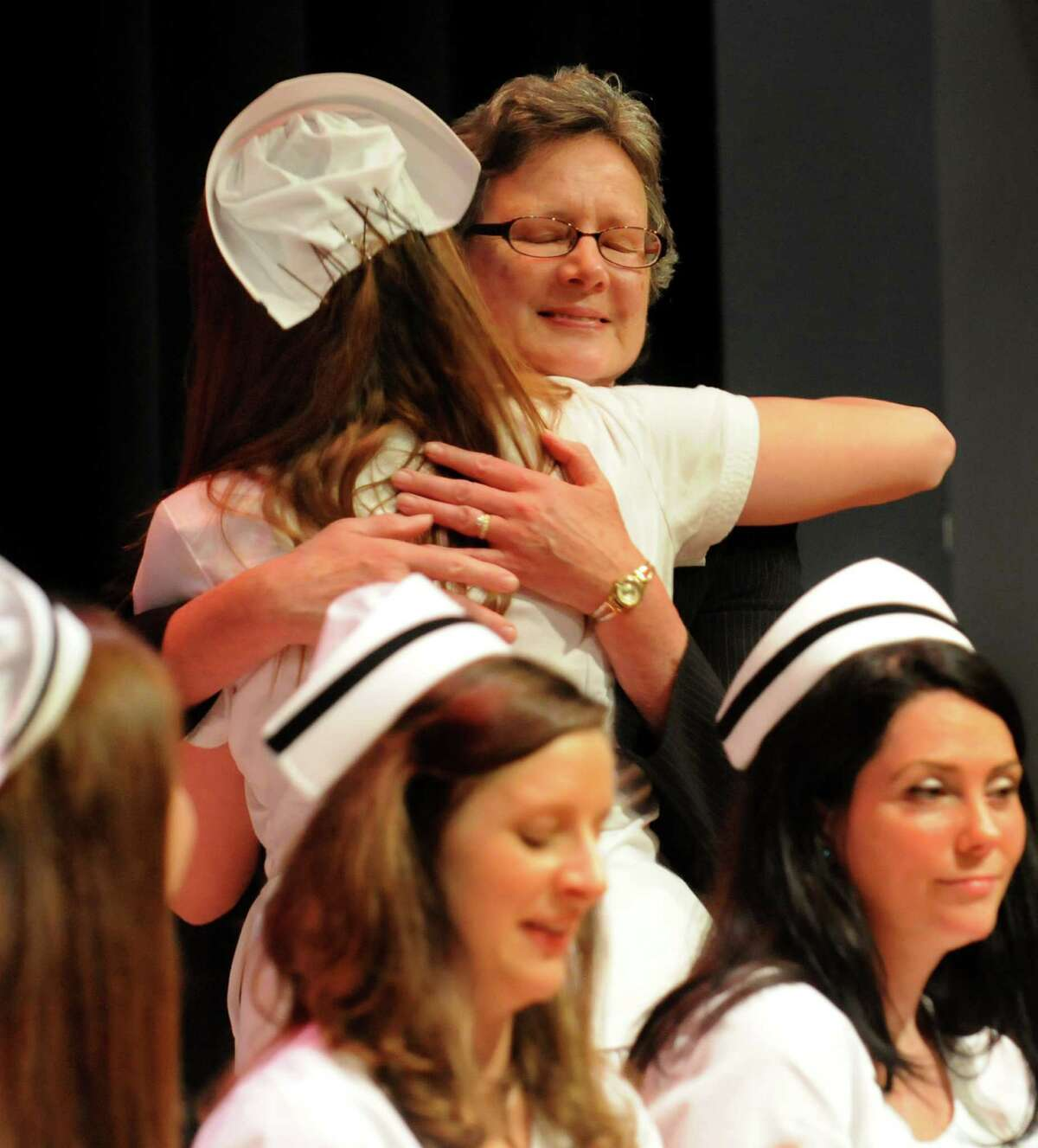 Susan Birkhead, director of the School of Nursing, top right, receives a hug from graduate Amanda Milem during the Samaritan Hospital School of Nursing college commencement on Thursday, May 9, 2013, at Hudson Valley Community College in Troy, N.Y. (Cindy Schultz / Times Union)