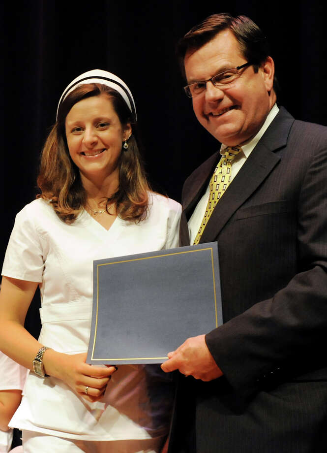 Graduate Rebecca Caouette, left, receives the Medical Staff Award from Norman Dascher, Jr. during the Samaritan Hospital School of Nursing college commencement on Thursday, May 9, 2013, at Hudson Valley Community College in Troy, N.Y. Dascher is the CEO of Samaritan and St. Mary's hospitals and Vice President of Acute Care Troy. (Cindy Schultz / Times Union) Photo: Cindy Schultz / 10022131A