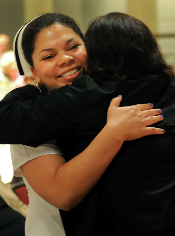 Graduate Korissa Gohlke, left, embraces faculty member Shanon Kress, during the Samaritan Hospital School of Nursing college commencement on Thursday, May 9, 2013, at Hudson Valley Community College in Troy, N.Y. (Cindy Schultz / Times Union) Photo: Cindy Schultz / 10022131A