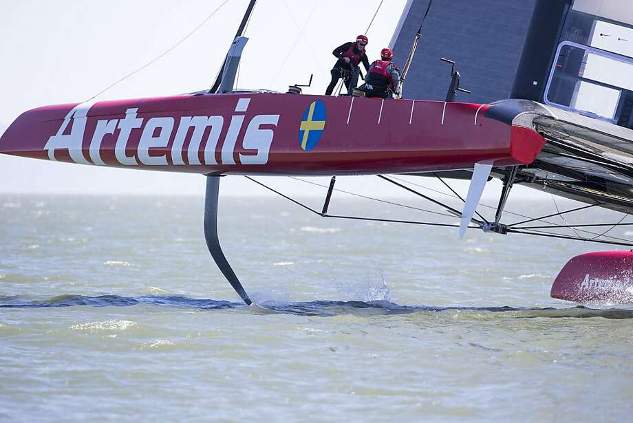 Artemis Racing's catamaran makes a test run on the bay last month. The hydrofoil extends from the boat into the water. Photo: Sander Van Der Borch, Sander Van Der Borch / Artemis R