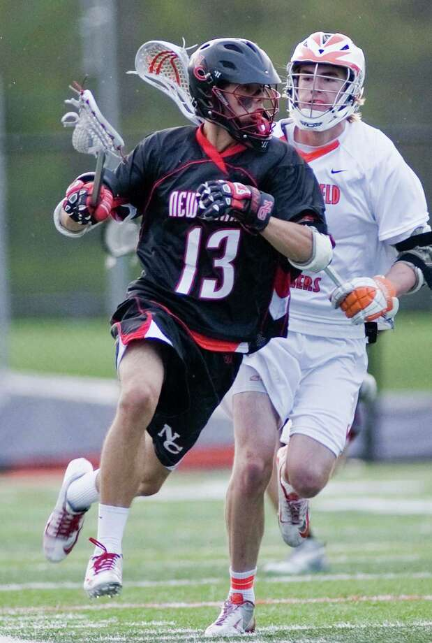 New Canaan High School's Seth Neeleman flies up the field during a game against Ridgefield High School, played at Ridgefield. Thursday, May 9, 2013 Photo: Scott Mullin / The News-Times Freelance