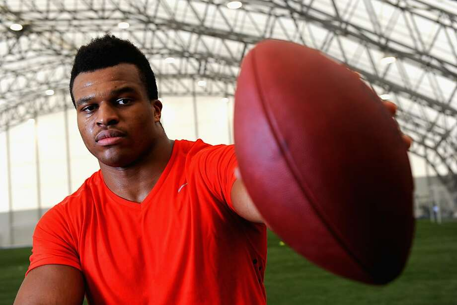 Lawrence Okoye poses for photographs during the NFL Media Day at The London Soccerdome on April 17, 2013 in London, England.  Photo: Tom Dulat, Getty Images