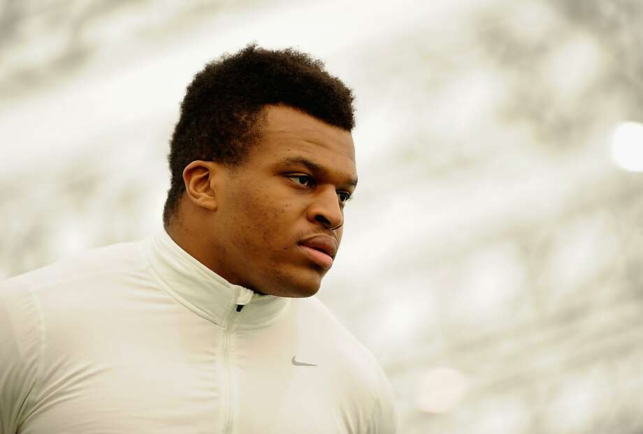 Lawrence Okoye, getting his first taste of football at the 49ers' training camp, was 12th at the London Olympics in the discus. Photo: Tom Dulat, Getty Images