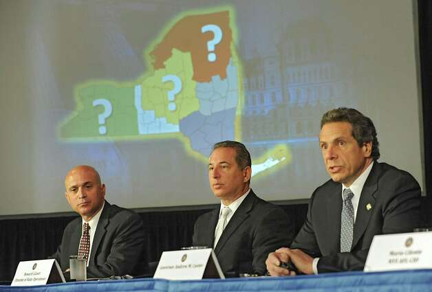 Governor Andew Cuomo, right, holds a press conference to discuss proposals on upstate casinos on Thursday, May 9, 2013 in Albany, N.Y. Also sitting with the governor are Steve Acquario, NYS Association of Counties, left, and Howard Glaser, Director of State Operations. (Lori Van Buren / Times Union) Photo: Lori Van Buren