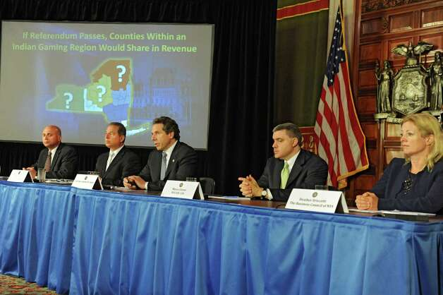 Governor Andew Cuomo, center, holds a press conference to discuss proposals on upstate casinos on Thursday, May 9, 2013 in Albany, N.Y. Also sitting with the governor, from left, are Steve Acquario, NYS Association of Counties, left, Howard Glaser, Director of State Operations, Mario Cilento, NYS AFL-CIO, and Heather Briccetti, The Business Council of NYS. (Lori Van Buren / Times Union) Photo: Lori Van Buren