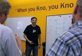 Osman Rashid (center), co-founder and CEO of Kno, leads a staff meeting at the digital interactive textbook provider's office in Santa Clara, Calif. on Friday, April 26, 2013.