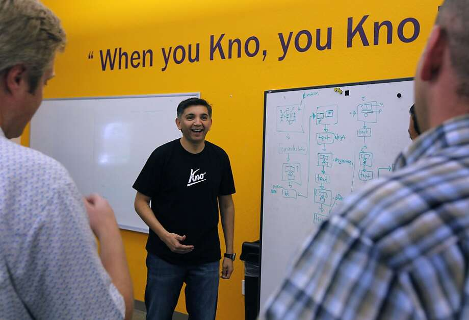 Osman Rashid (center), CEO of Kno, leads a staff meeting at the digital interactive textbook provider's office in Santa Clara. Photo: Paul Chinn, The Chronicle