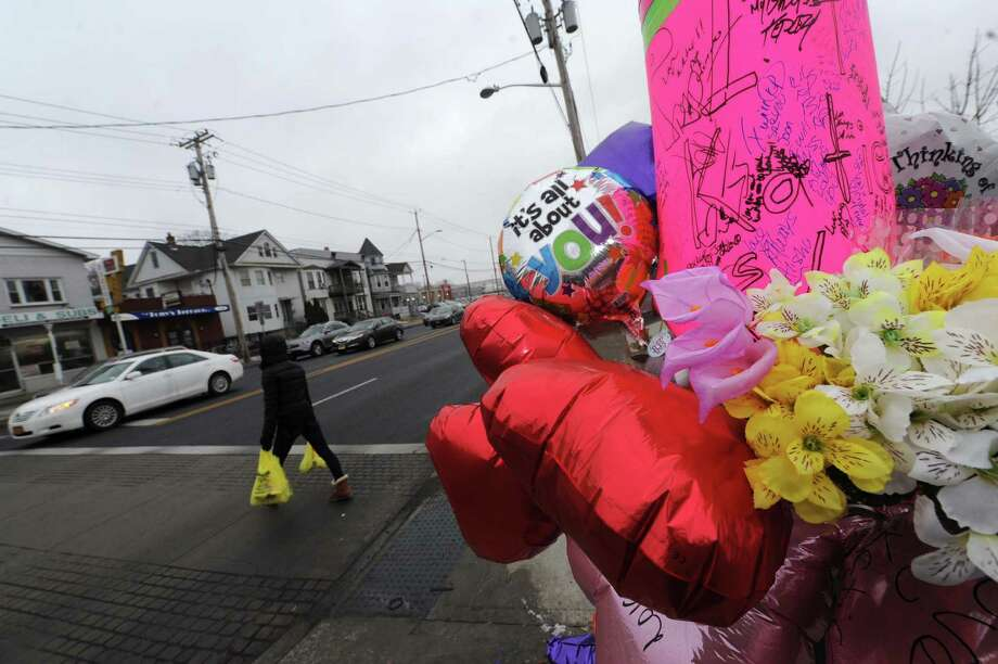 A memorial set up on corner in memory of Katherine Parker an Albany woman who died after being hit by a car near this spot at King and Central Avenues on Saturday Feb. 23, 2013 in Albany, N.Y. (Michael P. Farrell/Times Union) Photo: Michael P. Farrell / 00021291A