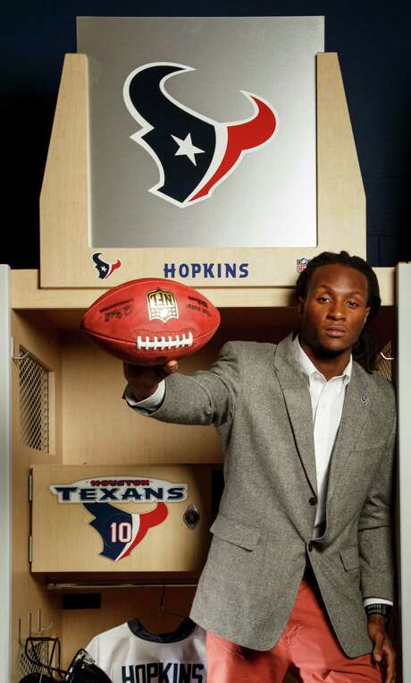 The Houston Texans' first-round draft pick, DeAndre Hopkins, poses for a portrait before a press conference at Reliant Stadium, Friday, April 26, 2013, in Houston.  Hopkins, a Clemson wide receiver, was selected as the 27th pick in the 2013 NFL draft.  ( Michael Paulsen / Houston Chronicle ) Photo: Michael Paulsen, Staff / © 2013 Houston Chronicle