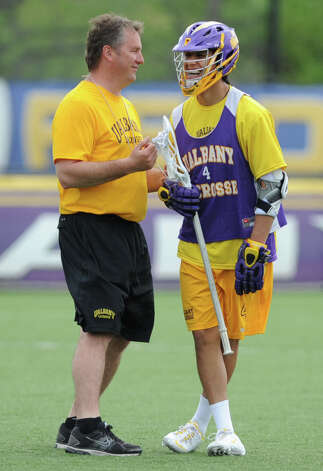 UAlbany men's lacrosse coach Scott Marr talks with Lyle Thompson during practice on Thursday, May 9, 2013 in Albany, N.Y. (Lori Van Buren / Times Union) Photo: Lori Van Buren / 00022358A