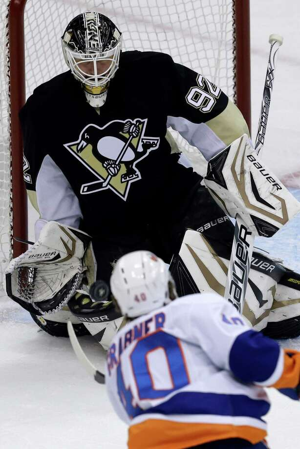 Pittsburgh Penguins goalie Tomas Vokoun (92) stops a shot by New York Islanders' Michael Grabner (40) during the first period of Game 5 of an NHL hockey Stanley Cup first-round playoff series, Thursday, May 9, 2013, in Pittsburgh. (AP Photo/Gene J. Puskar) Photo: Gene J. Puskar