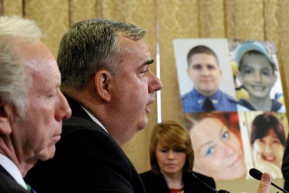"Boston Police Commissioner Edward Davis testifies before the House Homeland Security Committee at a hearing on ""The Boston Bombings: A First Look,"" on Capitol Hill in Washington, Thursday, May 9, 2013. Former Sen. Joeseph Lieberman, I-Conn., sits at left, and photos of those who were killed at the Boston Marathon bombing are at right. (AP Photo/Susan Walsh) Photo: Susan Walsh"