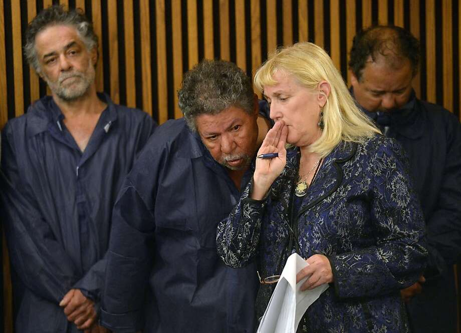 "The Castro brothers (L-R) Onil, Pedro and Ariel are arraigned at Cleveland Municipal Court for the kidnapping of three women in Cleveland, May 9, 2013 in Cleveland, Ohio. ARiel Castro appeared in court Thursday to faces charges that he kidnapped and raped three young women and held them in his home for a decade. The 52-year-old from Cleveland, Ohio did not enter a plea and stood with his head bowed while the court set a large bond of two million dollars per case, effectively ensuring that he will remain in detention. Ariel Castro was presented to the court by public defender Kathleen DeMetz(2nd-R), who said he was ""charged with kidnapping and rape on one charge, kidnapping and rape on the second, kidnapping and rape on the third, and kidnapping on the fourth."" His brothers were not charged with any crimes, but had old outstanding misdemeanor charges against them dropped.  Photo: Emmanuel Dunand, AFP/Getty Images"