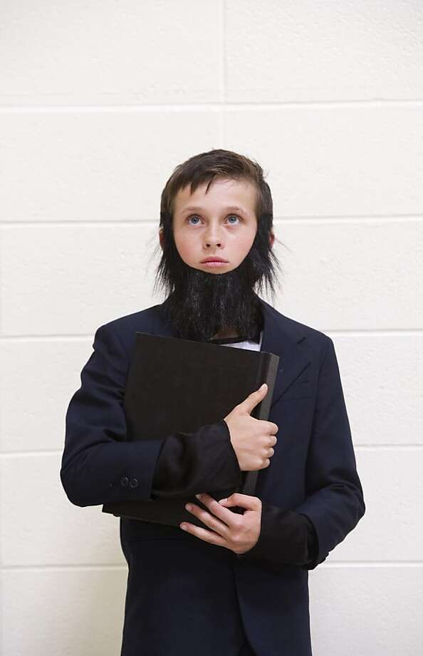 Fourth-grader Justin Waiz portrays Abraham Lincoln during St. John Catholic School's annual Indiana Wax Museum where the two fourth grade classes impersonate famous Indiana individuals at St. John Catholic School in Newburgh, Ind. on Thursday afternoon, May 9, 2013. Thirty-four fourth graders dressed up as famous Indiana characters and posed for 15-minute periods during the event.  Photo: Denny Simmons, Associated Press