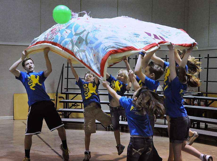 After this, how about some pillow dodgeball, gang? Students from Providence Classical Academy play quilt 