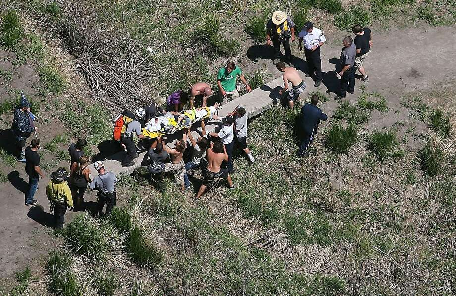 Search and Rescue respond to an injured BASE jumper  at the bottom of the Perrine Bridge Thursday, May 9, 2013 in Twin Falls, Idaho.  Photo: Drew Nash, Associated Press