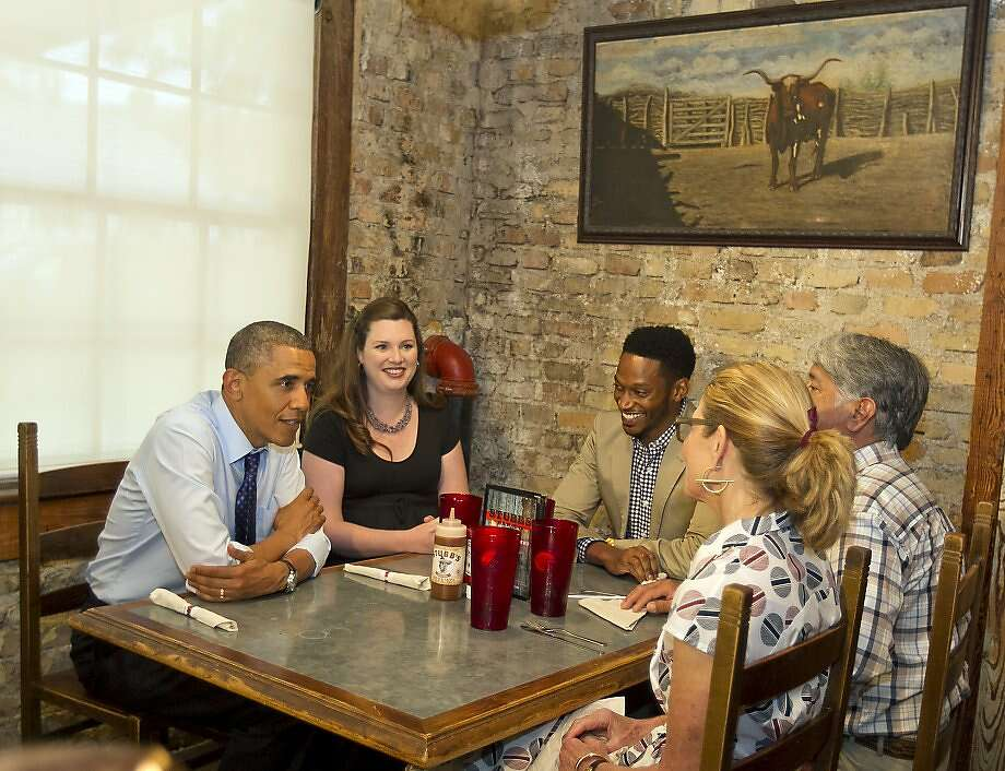 President Barack Obama has lunch and visits with patrons at Stubb's BBQ restaurant in Austin, Texas, on Thursday, May 9, 2013.  Photo: Rodolfo Gonzalez, Associated Press