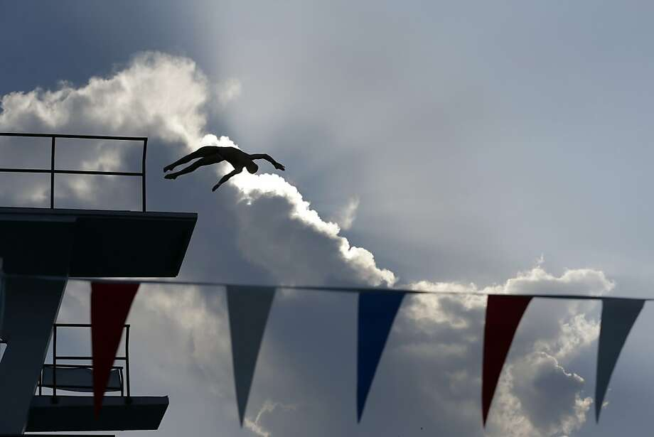 Out of the clouds, into the pool: Steele Johnson launches himself off the men's 10-meter platform during the USA Diving Grand Prix in Fort Lauderdale, Fla. Photo: Wilfredo Lee, Associated Press