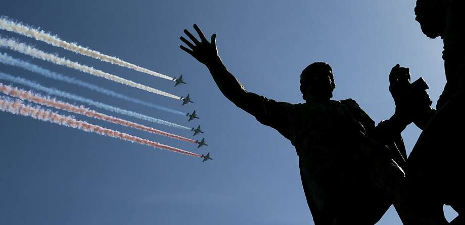 Russian air force fighters fly over Red Square during a Victory Day parade on Thursday, May 9, 2013. President Vladimir Putin's short speech Thursday came at the culmination of Victory Day, marking the defeat of Nazi Germany 68 years ago. It is Russia's most important secular holiday, honoring the huge military and civilian losses of World War II and showing off the country's modern arsenal. Photo: Ivan Sekretarev, Associated Press