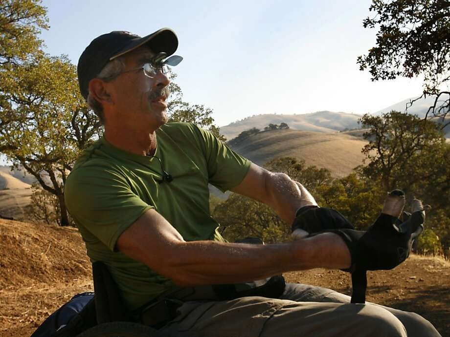Bob Coomber of Livermore puts on his well worn gloves, showing his muscular forearms as he heads up Miwok Trail in Morgan Territory Regional Park near Livermore on October 26, 2008. Day 2 of a 4 day trek along the Diablo Regional Trail. Photo: Michael Maloney, The Chronicle