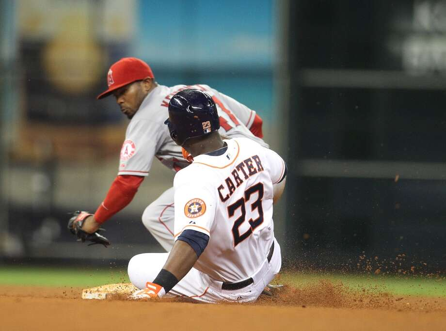 Astros left fielder Chris Carter (23) is  tagged out at second by Angels second baseman Howie Kendrick.