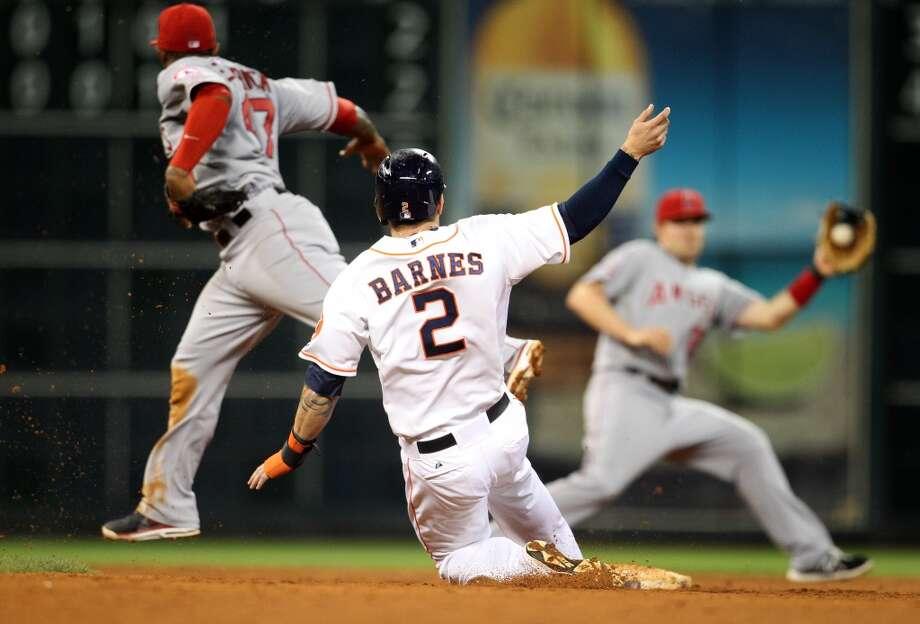 Astros right fielder Brandon Barnes (2) singles to right field, allowing Ronny Cedeno to score. Photo: Karen Warren, Houston Chronicle
