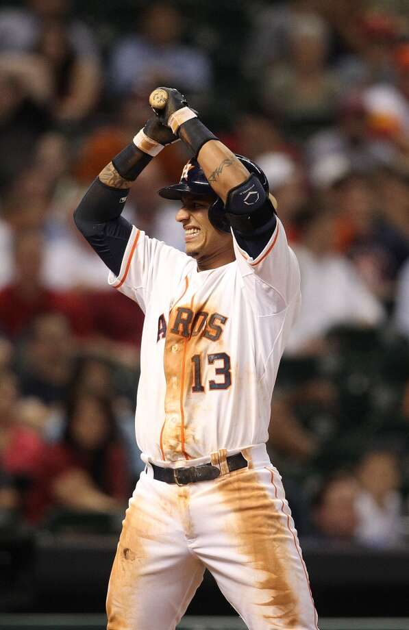 Astros shortstop Ronny Cedeno (13) reacts as a strike was called.