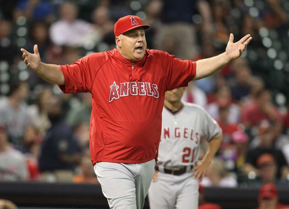 May 9 : Angles 6, Astros 5Angels manager Mike Scioscia screams at the officiating crew after Astros relief pitcher Wesley Wright was replaced mid-warmup by relief pitcher Hector Ambriz. Photo: Karen Warren, Houston Chronicle