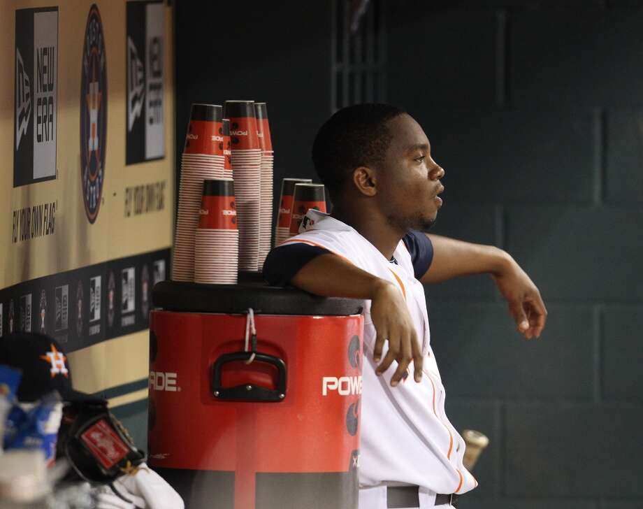 Astros relief pitcher Wesley Wright sits in the dugout after getting pulled mid-warmup. Photo: Karen Warren, Houston Chronicle