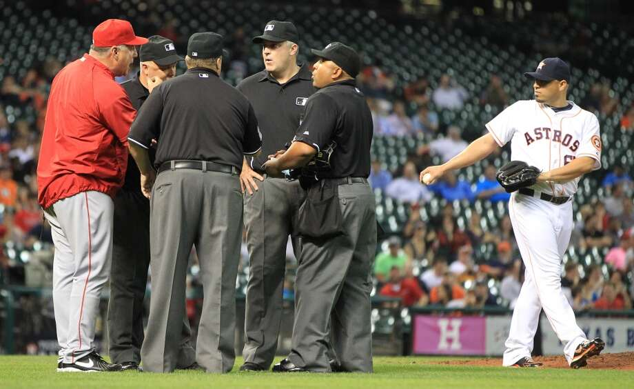 Angels manager Mike Scioscia screams at the officiating crew after Astros relief pitcher Wesley Wright was replaced mid-warmup by relief pitcher Hector Ambriz.
