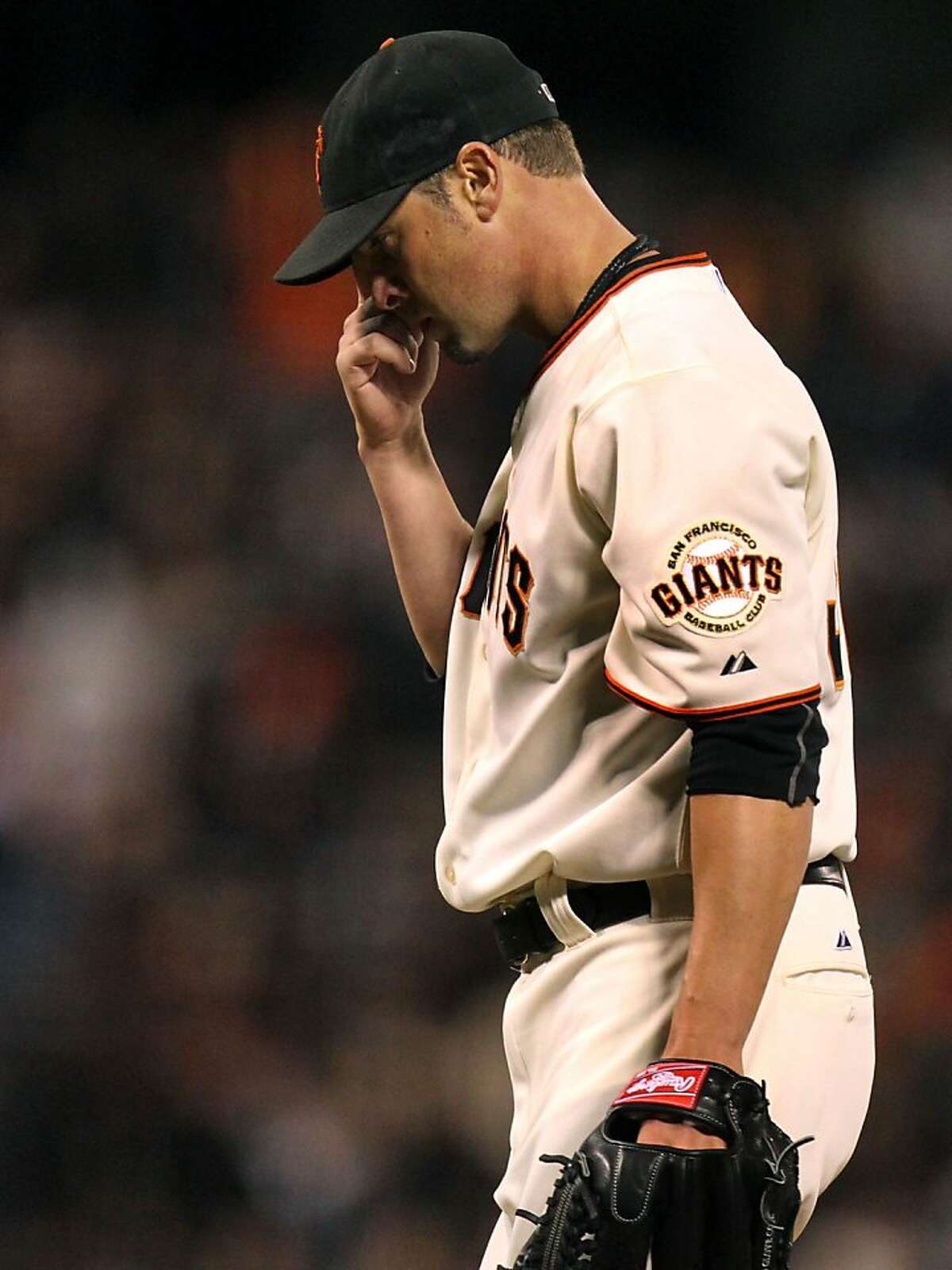 San Francisco Giants starting pitcher Ryan Vogelsong steps off the pitchers mound after being relieved in the 5th inning of their MLB baseball game with the Atlanta Braves Thursday, May 9, 2013 in San Francisco, Calif.