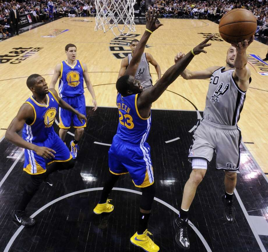 The Spurs' Manu Ginobili shoots around the Warriors' Draymond Green during first half action of Game 2 in the NBA Western Conference semifinals Wednesday May 8, 2013 at the AT&T Center. The Warriors won 100-91.
