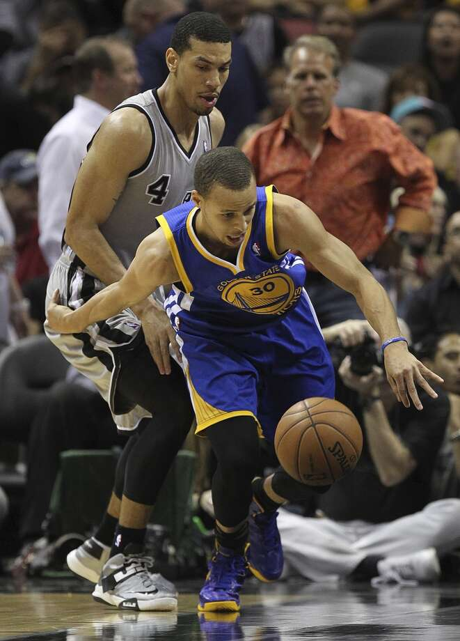 The Warriors' Stephen Curry steals the ball away from the Spurs' Danny Green during the second half of Game 2 in the NBA Western Conference semifinals at the AT&T Center, Wednesday, May 8, 2013. The Warriors won, 100-91 to even the series at 1-1.