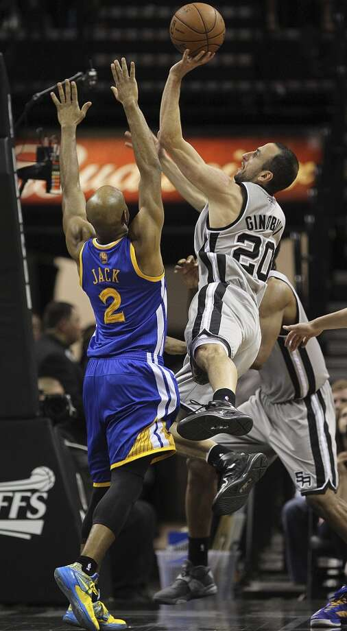 The Spurs' Manu Ginobili shoots over the Warriors' Jarrett Jack during the second half of Game 2 in the NBA Western Conference semifinals at the AT&T Center, Wednesday, May 8, 2013. The Warriors won, 100-91 to even the series at 1-1.