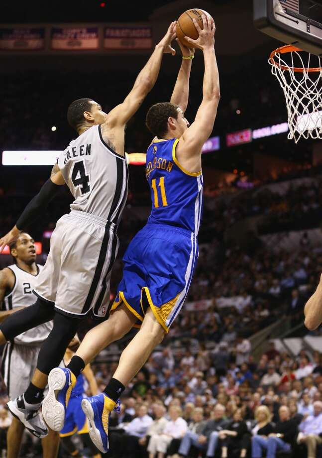Klay Thompson 11 of the Warriors makes the slam dunk against Danny Green 4 of the Spurs during Game Two of the Western Conference Semifinals of the 2013 NBA Playoffs at AT&T Center on May 8, 2013.