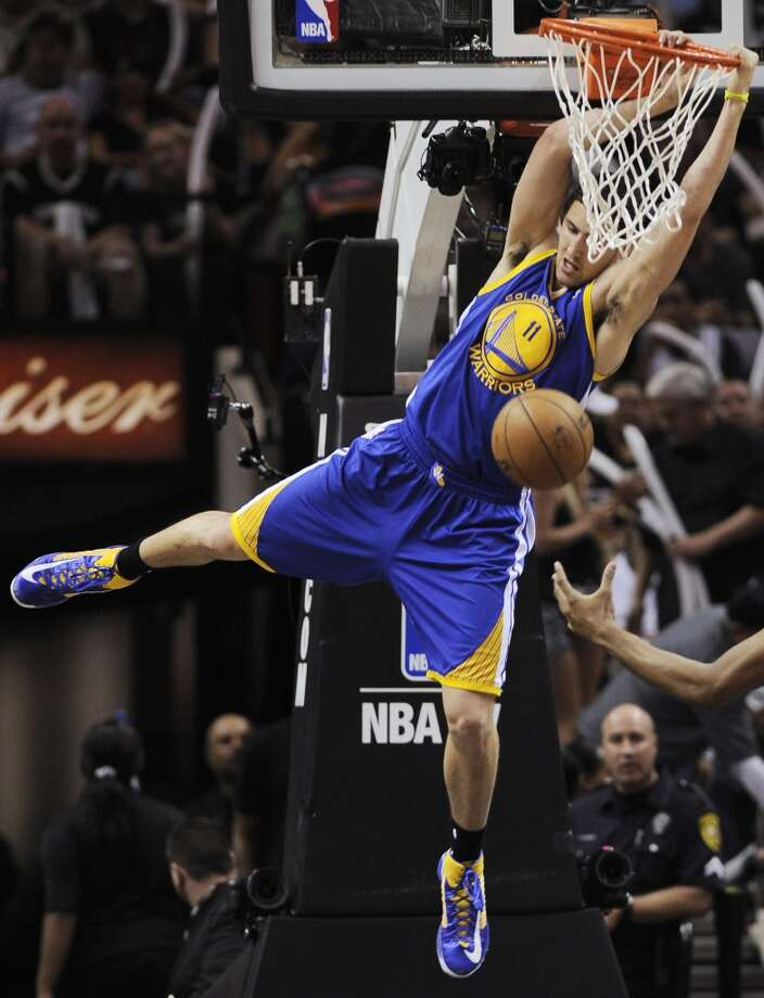 The Warriors' Klay Thompson (11) dunks against the Spurs during the second half of Game 2 of the Western Conference semifinal NBA basketball playoff series, Wednesday, May 8, 2013, in San Antonio.