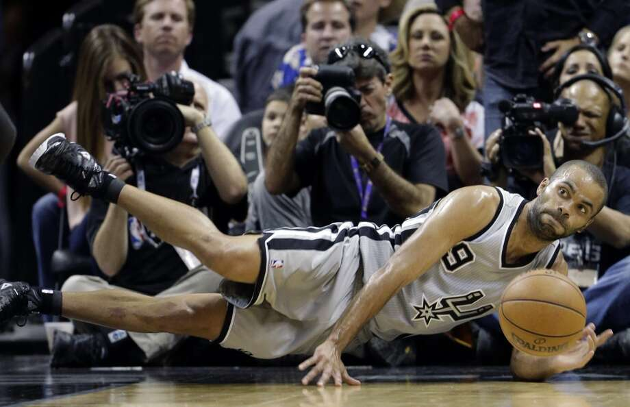 The Spurs' Tony Parker (9) dives for a loose ball against the Warriors during the first half of Game 2 in their Western Conference semifinal NBA basketball playoff series, Wednesday, May 8, 2013, in San Antonio.