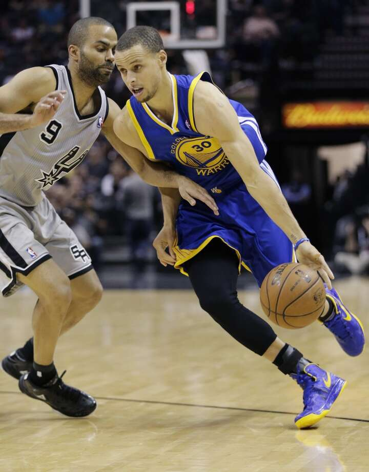 The Warriors' Stephen Curry, right, drives around the Spurs' Tony Parker (9) during the second half in Game 2 of a Western Conference semifinal NBA basketball playoff series, Wednesday, May 8, 2013, in San Antonio.