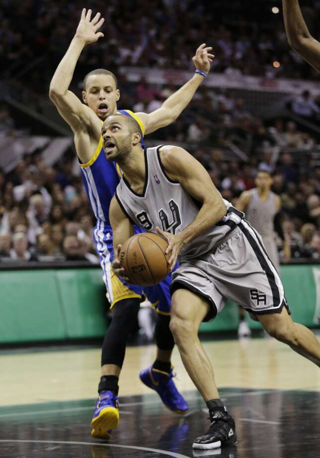 The Spurs' Tony Parker (9) drives on the Warriors' Stephen Curry during the first half at Game 2 of a Western Conference semifinal NBA basketball playoff series, Wednesday, May 8, 2013, in San Antonio.